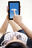 Woman with digital tablet on bed Royalty Free Stock Photography