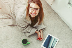 Woman with digital tablet and coffee royalty free stock photography