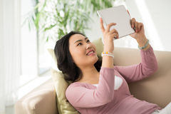 Woman with digital tablet Royalty Free Stock Photography
