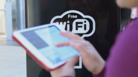 Woman with digital tablet in free Wi-Fi area stock video footage