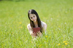 Woman with digital tablet. Happy young woman with digital tablet on  meadow Stock Photo