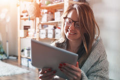 Woman with digital tablet at home. Pretty woman with digital tablet at home Royalty Free Stock Photos