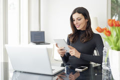 Woman with digital tablet in the office Royalty Free Stock Photo
