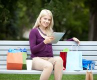 Woman with Digital Tablet in Park Stock Photography