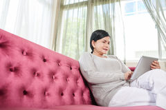 Woman with digital tablet Stock Photos