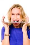 Woman with digital tablet between teeth Stock Images