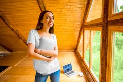 Woman with digital tablet in wooden house Stock Photos