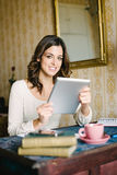 Woman with digital tablet working at vintage home Royalty Free Stock Photo