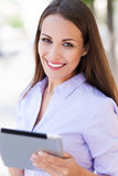 Woman with digital tablet. Young woman with digital tablet Royalty Free Stock Photography