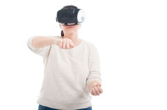 Woman with digital VR headset experiencing gaming Royalty Free Stock Photography