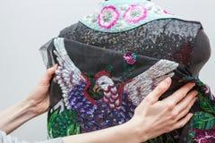 A woman creates exclusive clothes. Stock Photos