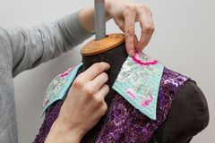 A woman creates exclusive clothes. Royalty Free Stock Photo