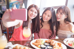Woman dine in restaurant. Beauty women selfie and dine in restaurant Royalty Free Stock Photo