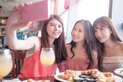 Woman dine in restaurant. Beauty women selfie and dine in restaurant Stock Photo