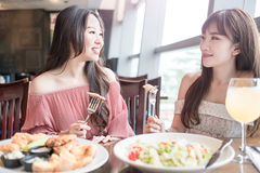 Woman dine in restaurant. Beauty women smile and dine in restaurant Royalty Free Stock Image