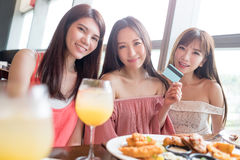 Woman dine in restaurant. Beauty women take credit card and dine in restaurant Stock Photography