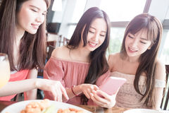 Woman dine in restaurant. Beauty women use phone and dine in restaurant Stock Photography