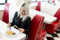 Woman in the diner Royalty Free Stock Photography