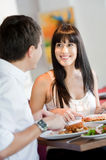 Woman Dining with Partner Stock Images