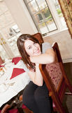 Woman in the dining room Stock Photography