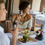Woman At Dinner. A young couple having dinner at a restaurant Royalty Free Stock Photo