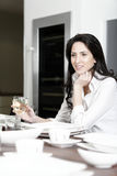Woman at the dinner table Royalty Free Stock Image