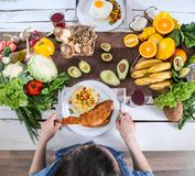 The woman at the dinner table with organic food , the view from the top royalty free stock photo