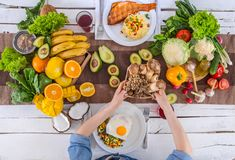 The woman at the dinner table with organic food , the view from the top royalty free stock photography
