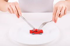 Woman with dinnerware and car model Royalty Free Stock Photos