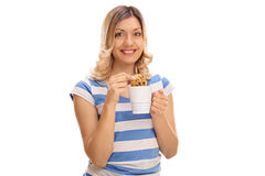 Woman dipping a cookie in milk Stock Photos