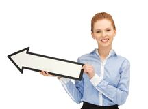 Woman with direction arrow sign Royalty Free Stock Image