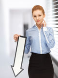 Woman with direction arrow sign Royalty Free Stock Photography