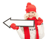Woman with direction arrow sign Stock Image