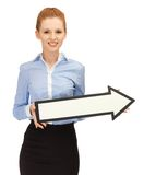 Woman with direction arrow sign Stock Images