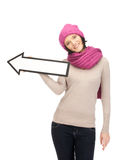 Woman with direction arrow sign Stock Photo