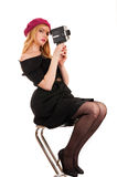 Woman director sitting with a video camera in hands Stock Image