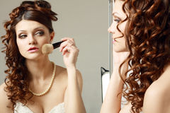 Woman directs a make-up. The young woman directs a make-up in the morning before wedding Royalty Free Stock Images