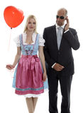 Woman in Dirndl. With Bodyguard royalty free stock image