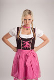 Woman with dirndl is angry Stock Photography