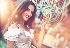 Woman in Dirndl costume with Gingerbread heart Stock Photo
