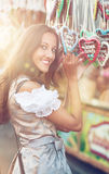 Woman in Dirndl costume with Gingerbread heart Royalty Free Stock Images
