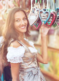 Woman in Dirndl costume with Gingerbread heart Stock Photos