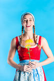 Woman in dirndl dress holding flowers Stock Photography