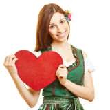 Woman in dirndl dress holding red Royalty Free Stock Photos