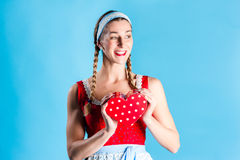Woman in dirndl dress opening gift Royalty Free Stock Image