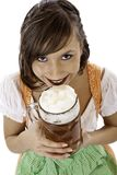 Woman with dirndl drinks Oktoberfest beer stein Royalty Free Stock Photo