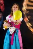 Woman in dirndl enjoying fun fair Stock Image
