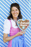 Woman in dirndl with gingerbread Royalty Free Stock Image