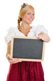 Woman with dirndl holding empty blackboard Stock Images