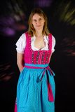 Woman in dirndl at Oktoberfest. Woman in dirndl at the Oktoberfest stock photos